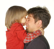 The son kisses the daddy. The daddy with the son. It is isolated on a white background stock image