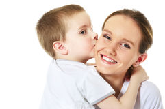 Son kisses his mum. Little son kisses his mum royalty free stock image