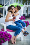 Son kisses mother at the resort outdoors.  Royalty Free Stock Photography