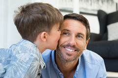 Son kissing father Royalty Free Stock Photography