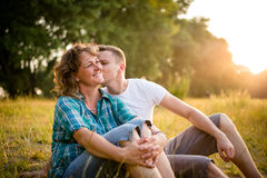 Son kissing her affectionate mother. Young adult boy kissing her mother on cheek Stock Photo