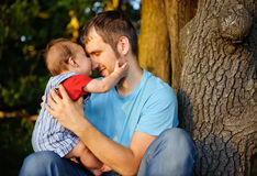 Son kissing his father Royalty Free Stock Photo