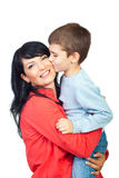 Son kissing his mother cheek. And she smiling isolated on white background, check also in this collection series Royalty Free Stock Photo