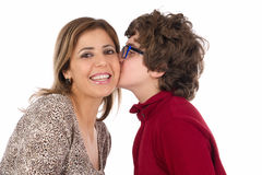 Son kissing his mother cheek. Isolated on white background Stock Image