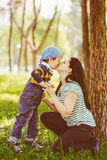 Son is kissing his mother. Toned image Royalty Free Stock Image