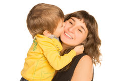 Son kissing his mother. On a white background Royalty Free Stock Photos