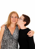 Son kissing his mother. Stock Images
