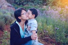 Son kissing his mum. Closeup Royalty Free Stock Photo