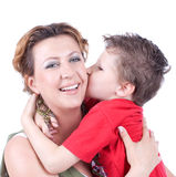 Son is kissing mother. Isolated over white background royalty free stock images