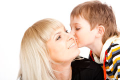 Son kissing mother. Portrait of a preschool boy kissing his mother Stock Photo