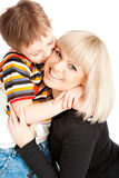 Son kissing  mother. Preschool son kissing his mother Royalty Free Stock Image