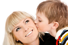 Son kissing mother. Portrait of a preschool boy kissing his mother stock photos