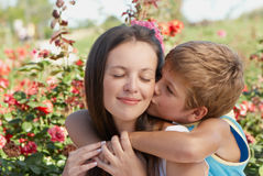 The son kissing mother. The women's day stock image
