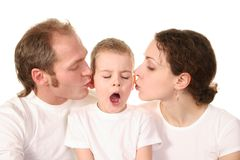 Son with kissing parents Royalty Free Stock Image