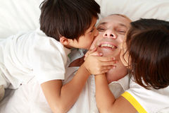 Son kissing their father. Against a white background Stock Photography