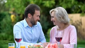 Son-in-law talking to mother-in-law, respectful relations and understanding. Stock photo royalty free stock image