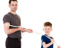 Son leads father caught the rope. Young son leads father caught the rope Stock Image