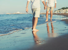 Son legs go to his father on the sea surf line close up image Stock Photo
