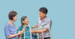 Son looking after elderly mother with caregiver stock photos