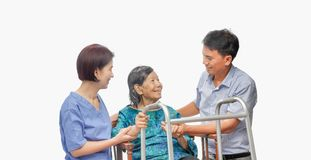Son looking after elderly mother with caregiver stock photo