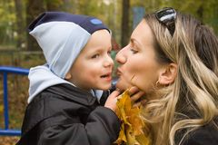 Son and mather. Are outside on the autumn day. they are happy Royalty Free Stock Image