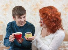 Son and mom drink tea at home stock photo