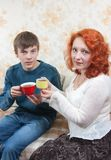 Son and mom drink tea at home royalty free stock photo