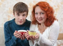 Son and mom drink tea at home Stock Photography