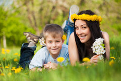 Son and mom in a green park. summer Royalty Free Stock Image