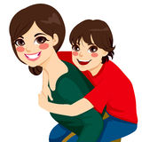 Son And Mom Piggyback Ride Stock Photo