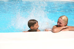 Son and mom in the pool. Son and mom swim and play in the pool royalty free stock photo