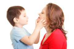 Son and mommy. Looking each other sideview photo over white stock images