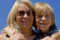 Son with mother Stock Images