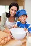 Son and mother baking cake. Together royalty free stock photo