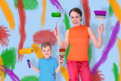 Son and mother draw with rollers and brushes. On a wall, collage royalty free stock images