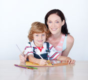 Son and mother drawing looking at the camera Stock Photo