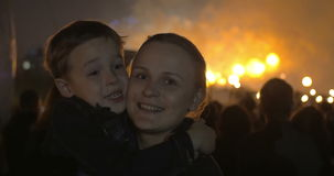 Son and mother on firework show stock footage