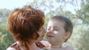 Son and mother. Happy smiling young boy with toy together with mother stock video footage