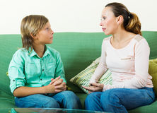 Son and  mother having serious talking. Teenager son and  mother having serious talking Royalty Free Stock Photography