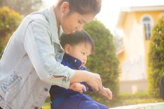 The son with the mother. In the park stock photography