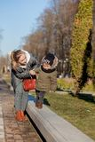Son and mother playing together in the park. Mother`s day.  stock photos