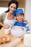 Son and mother preparing cake. Together Royalty Free Stock Photo