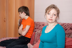 Son and mother after quarrel. Teen  son and mother having quarrel at home Royalty Free Stock Photo