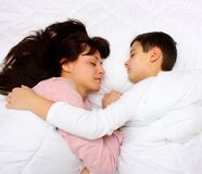 Son and mother sleeping face to face Royalty Free Stock Image