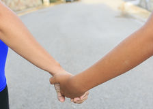 Son and mother with their hands together.  Stock Images