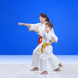 Son and mother are training punch arm. Son and mother are training punch Stock Images