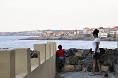 Son and mother walking on street of ?ncient city of Sozopol in Bulgaria Stock Images