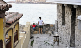 Son and mother walking on street of ?ncient city of Sozopol in Bulgaria Stock Image