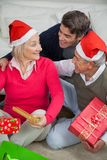 Son With Parents Holding Christmas Presents Royalty Free Stock Photos