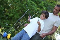Son playing with diabolo. In the park stock images